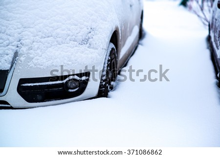 Cars covered with snow after a winter snowstorm - stock photo