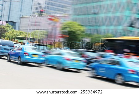 cars driving on the street - the effect of speed - stock photo