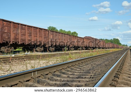 Cars from a coal train on a railway station - stock photo