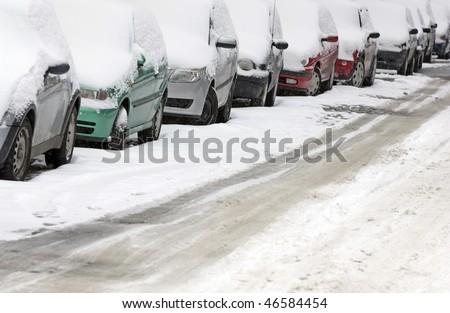 cars in city street in winter - stock photo