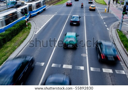 Cars in motion blur on a street of Wroclaw - city with the biggest traffic jams in Europe - stock photo