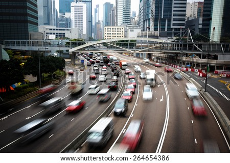Cars In motion blur on road Hong Kong China - stock photo