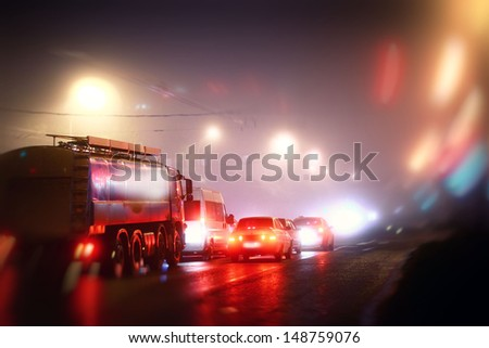cars in the night, the highway fog - stock photo