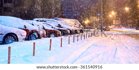 Cars in the parking lot in the winter - stock photo