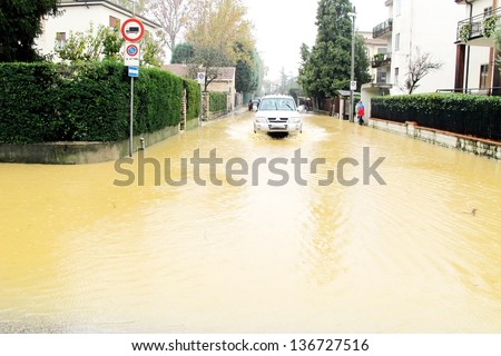 cars in the streets and roads submerged by the mud of the flood after the flooding of the River 11 - stock photo