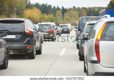 cars in traffic jam in a highway during rush hour - stock photo