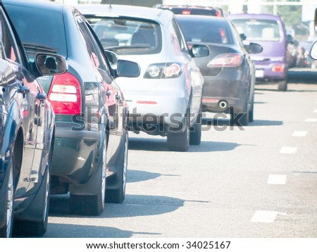 Cars line up against a detour caused by a fatal accident on the highway during rush hour - stock photo