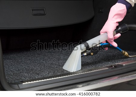 Cars luggage carrier chemical cleaning with professionally extraction method. Early spring cleaning or regular clean up. - stock photo