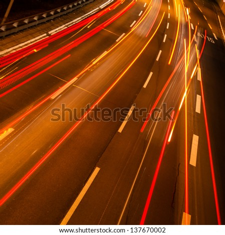 cars on a highway by night