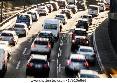 cars on a highway in curve - stock photo