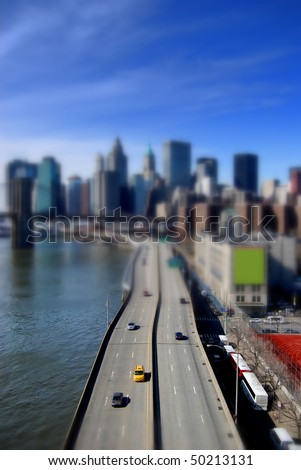 Cars on a highway leading to Manhattan - stock photo