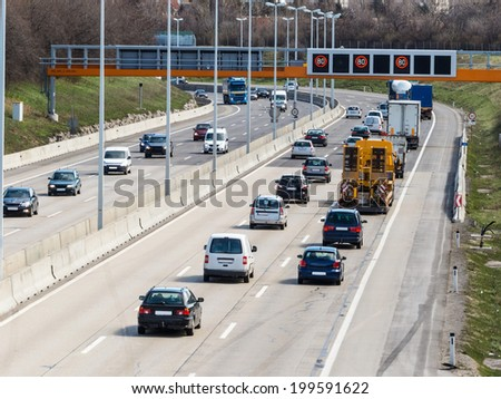 cars on a highway with a speed limit icon photos of transport, mobility, environmental protection - stock photo