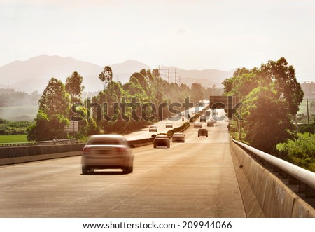 Cars on highway - stock photo