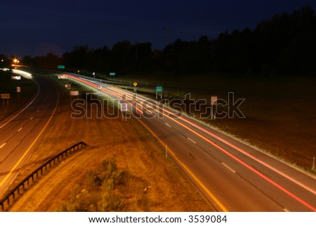 Cars on highway at night