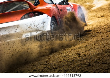 Cars on the autocross. Racing in the open air with dust.