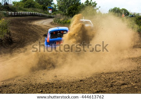 Cars on the autocross. Racing in the open air with dust. Competitions on cars
