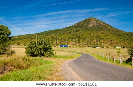 cars on the road in a  mountain landscape - stock photo