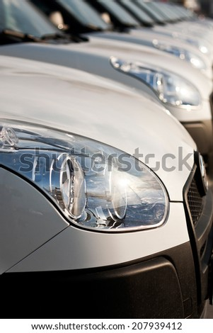 Cars parked in a row on a lot - stock photo