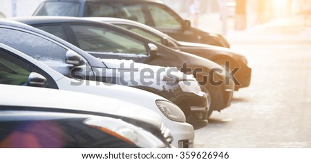 Cars parked in the city when the weather is bad.