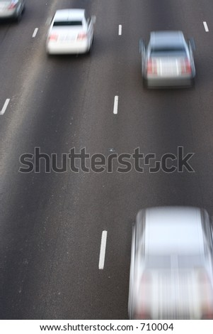 Cars passing on the freeway - stock photo