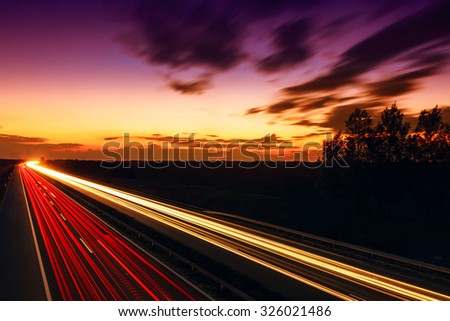 Cars speeding on a highway, Hungary - stock photo
