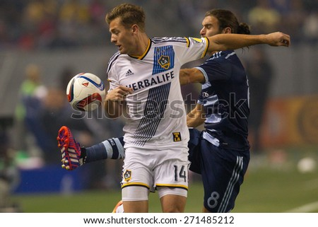 CARSON, CA. - APR 18: Robbie Rogers & Graham Zusi (R) in action during the L.A. Galaxy game against Sporting Kansas City on April 18, 2015 at the StubHub Center in Carson, California. - stock photo