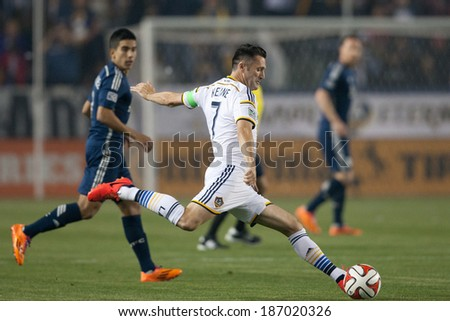 CARSON, CA - APRIL 12: Los Angeles Galaxy F Robbie Keane #7 during the MLS game between the Los Angeles Galaxy & the Vancouver Whitecaps on April 12th 2014 at the StubHub Center. - stock photo