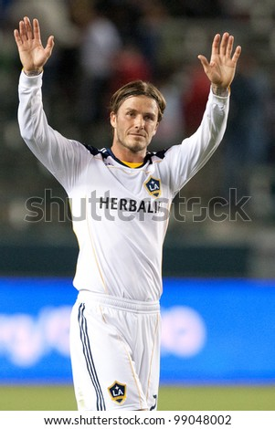 CARSON, CA. - APRIL 23: Los Angeles Galaxy M David Beckham #23 during the MLS game between the Portland Timbers & the Los Angeles Galaxy on April 23, 2011 at the Home Depot Center in Carson, CA. - stock photo