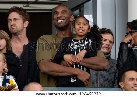 CARSON, CA - DECEMBER 1: Kobe Bryant and his daughter at the 2012 MLS Cup Final at the Home Depot Center on December 1, 2012 in Carson, California. - stock photo