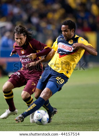 CARSON, CA. - JANUARY 9: Daniel Alcantar (L) & Jean Beausejour (R) in action during the InterLiga 2010 match of Club America & Estudiantes Tecos at the Home Depot Center January 9, 2010 in Carson, CA. - stock photo