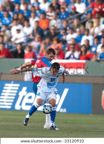 CARSON, CA. - JULY 3: Concacaf Gold Cup soccer match, Costa Rica vs. El Salvador at the Home Depot center in Carson. Gonzalo Segarews and Salvador Coreas fighting for the ball on July 3, 2009.