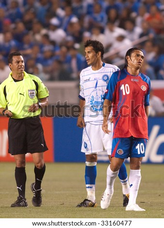 CARSON, CA. - JULY 3: Concacaf Gold Cup soccer match, Costa Rica vs. El Salvador at the Home Depot Center in Carson. Ramon Sanchez and Walter Centeno with the referee talking to them. July 3, 2009.