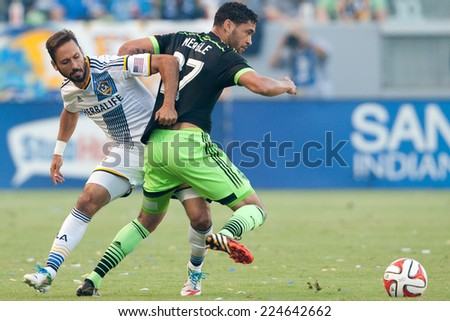 CARSON, CA - OCT 19: Marcelo Sarvas & Lamar Neagle (R) fight for the ball during the Los Angeles Galaxy MLS game against the Seattle Sounders on October 19th 2014 at the StubHub Center. - stock photo