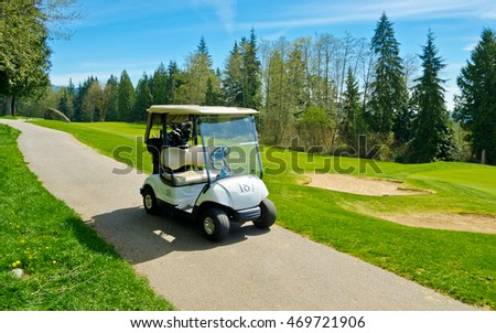 Cart, buggy at the beautiful golf course with sand bunkers. Vancouver, Canada.