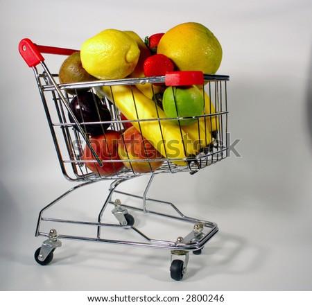 cart full of organic fruits - stock photo
