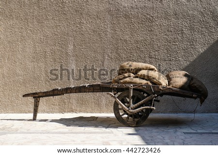 Cart loaded with coffee bags - stock photo