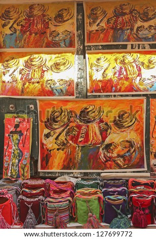 CARTAGENA- JAN 10: souvenirs on January 10, 2012 in Cartagena, Colombia. Paintings and crafts typical of the Andean culture. - stock photo