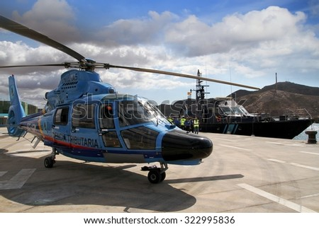 CARTAGENA, SPAIN - SEPTEMBER 24: Details of the Eurocopter AS-365N-3 Dauphin 2 of the Spanish Customs stopped in Cartagena in the Mediterranean province of Murcia, on september 24, 2015 in Cartagena. - stock photo