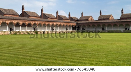 Carter house of Pavia, cell complex over a grass field - stock photo