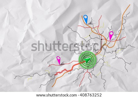 Cartographic illustrations map navigation on crumpled sheet of paper with vehicle tracing the distance. - stock photo