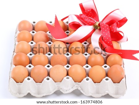 Carton box of thirty eggs isolated on white background. Clipping path include. - stock photo