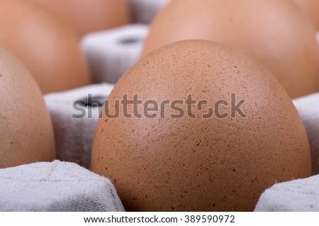Carton of eggs from chicken farm (selective focus) - stock photo