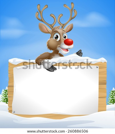 Cartoon Christmas Reindeer Sign of one of Santaâ??s cute red nosed reindeer a snow covered sign and pointing sign - stock photo