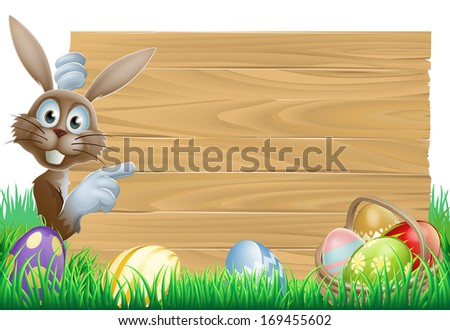 Cartoon Easter rabbit bunny pointing at a sign, decorated Easter eggs and basket in front
