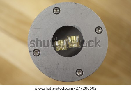 Cartridge case head split and mounted for hardness testing - stock photo