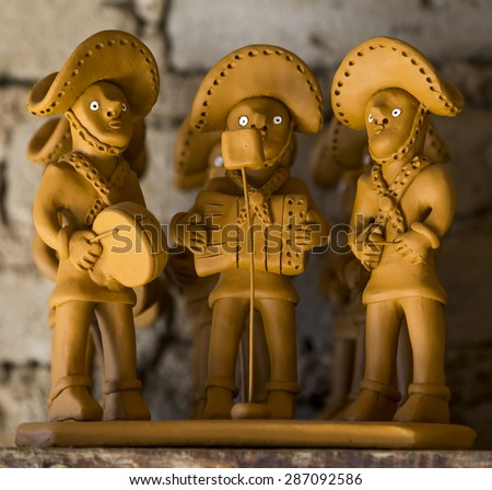 CARUARU, BRAZIL - MAY 6: Clay sculpture representing a typical Brazilian pifanos band very common in the northeast of Brazil photographed in Caruaru, Pernambuco, Brazil on May 6, 2015. - stock photo