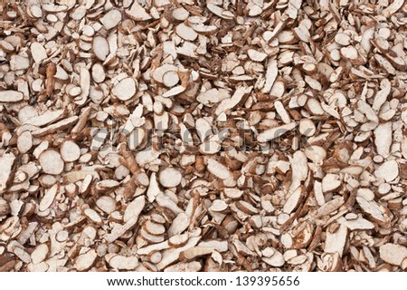 carve casava drying in the sun - stock photo