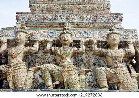 Carved and sculpture angel of Wat Arun Ratchawararam Ratchawaramahawihan or Wat Arun  location at Chao Phraya Riverside in Bangkok Thailand . One of the most attractive temples in Thailand - stock photo