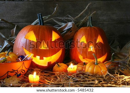 Carved jack-o-lanterns lit for halloween - stock photo