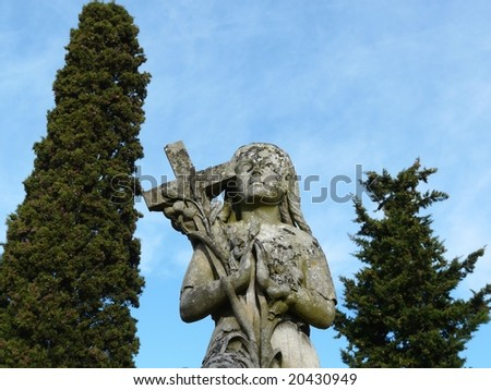 Carved statue in a graveyard - stock photo